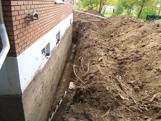 French drain repair for Drain de garage installation